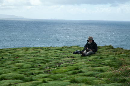 image of Beth sketching at Downpatrick Head