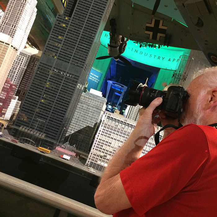Image of Bob Emmott photographing at Museum of Science and Industry